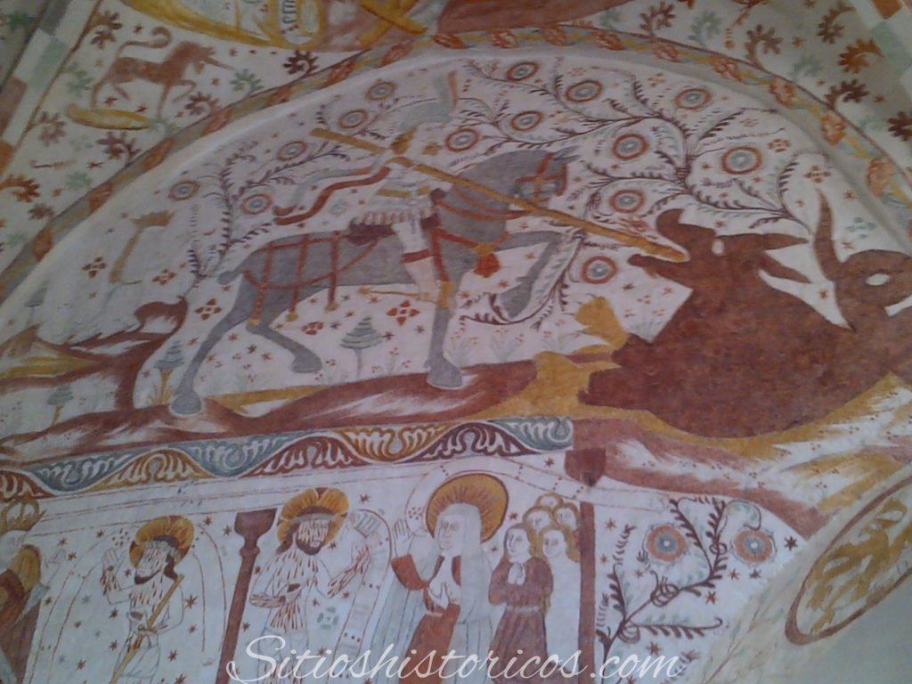 San Jorge traspasando con su lanza al dragón.